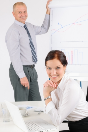 Giving presentation executive businessman during meeting write at flipchart Stock Photo - 14102076