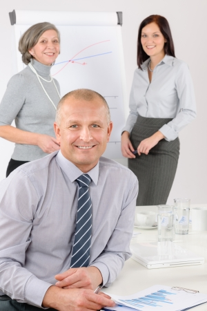 Smiling businessman during team meeting with colleagues give presentation Stock Photo - 14102109