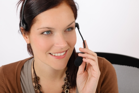 Friendly help desk woman smiling call center operator phone headset photo