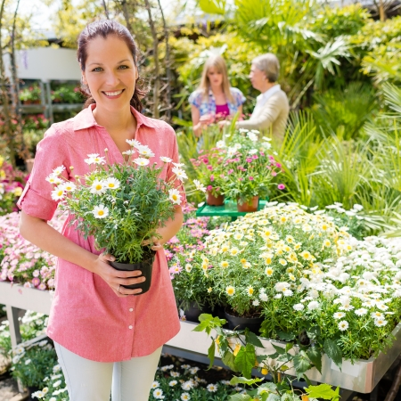 garden center: Woman shopping at flower shop green house garden centre Stock Photo
