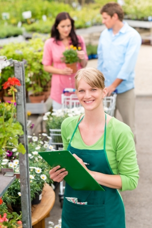 Female florist working at garden center do retail inventory Stock Photo - 14181844