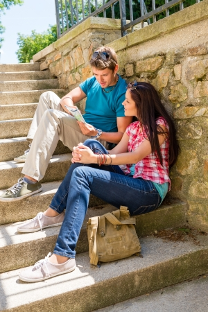 Young couple looking at city map sunny day sightseeing together Stock Photo - 14216465