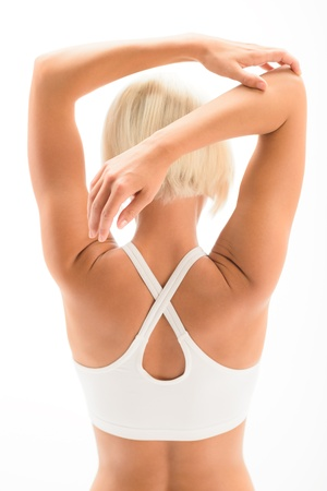 triceps: Back view of fitness woman stretching arms isolated on white Stock Photo