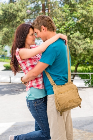Affectionate young couple hugging looking at each other photo