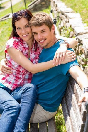 lovers park: Happy young couple sitting bench in park love people portrait Stock Photo