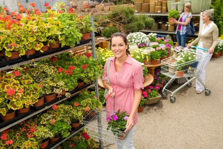 Young woman shopping flowers at garden center green house Stock Photo - 14381136
