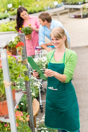 Female florist working at garden centre retail inventory Stock Photo - 14381063