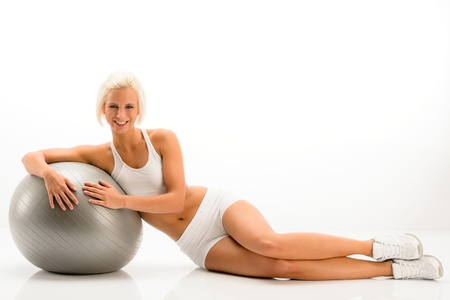 Sportive woman leaning on gym ball on white background Stock Photo - 14381053