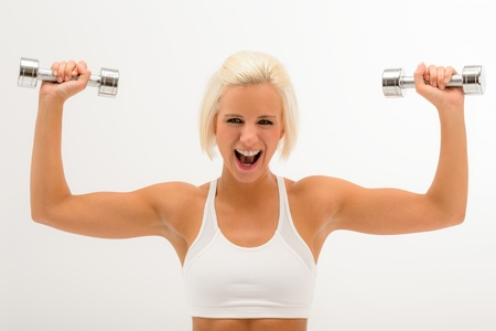 Shouting fitness woman lift dumbbells muscular arms isolated on white photo