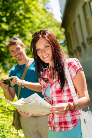 Young tourist couple travel holiday with map and photographing camera Stock Photo - 14381141