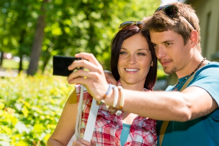 Young couple in love take picture of themselves outdoor photo