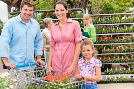 Young family shopping at garden centre flower market photo