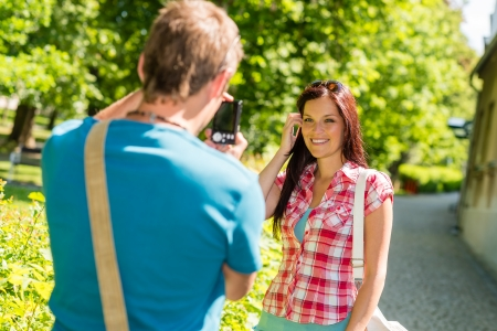 Young man take picture of his girlfriend outdoor city Stock Photo - 14412244