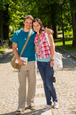 Young couple in city park happy tourists on summer holiday photo