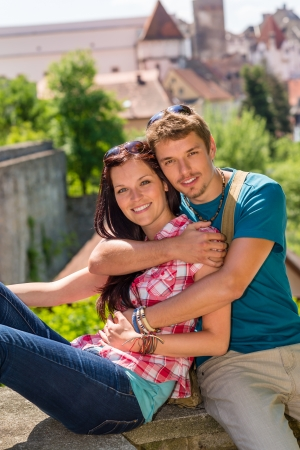 Young happy couple embracing enjoy city view smiling travel vacation photo