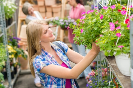 Young woman shopping flowers at market garden centre Stock Photo - 14449941