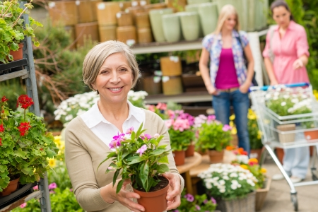 Senior lady shopping for flowers at garden centre smiling Stock Photo - 14449944