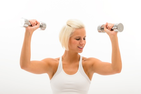 triceps: Fitness woman exercise biceps in studio lifting dumbbells