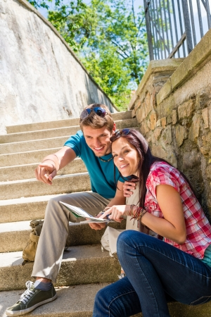 Young couple on holiday with city map point direction smiling Stock Photo - 14472720