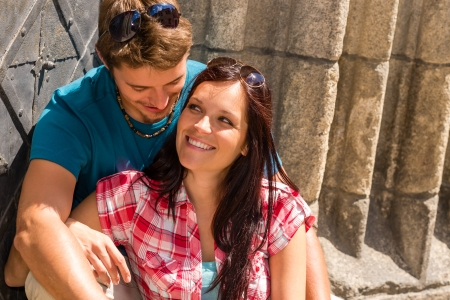Young couple sitting on building steps smiling enjoy love moment photo