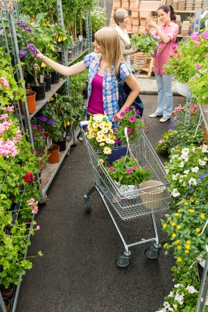 sowbread: Young woman shopping flowers at market garden centre