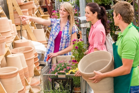 garden center: Male worker at garden centre store selling clay pots