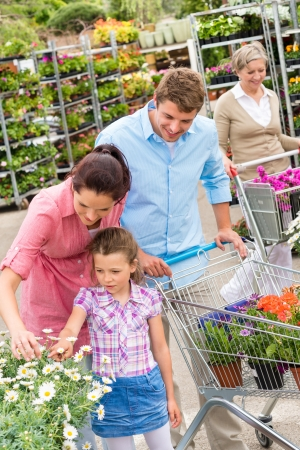 product range: Young family choosing flowers at garden centre retail store
