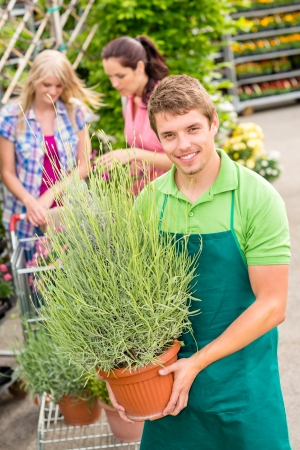 Male garden centre worker hold potted plant photo
