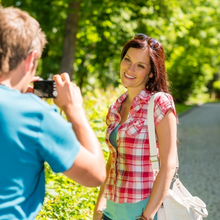 Young man take picture of his girlfriend outdoor city photo