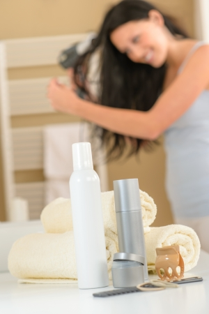 Close-up hair products in bathroom brunette woman drying hair Stock Photo - 14583503