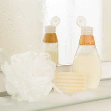 Close-up of bathroom body care products on shelf mirror reflection photo