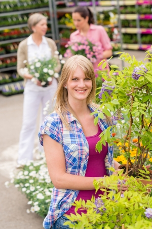 Smiling woman at garden centre shopping for house plants Stock Photo - 14639747