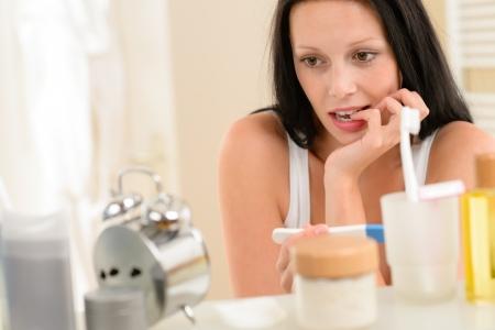 enceinte: Impatient brunette woman in bathroom waiting for pregnancy test result Stock Photo