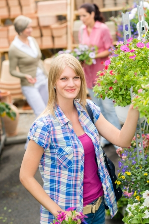 Young woman shopping flowers at market garden centre Stock Photo - 14735474