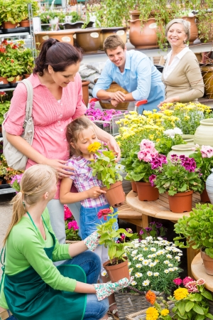 Little girl with parents picking flowers from garden shop Stock Photo - 14735491