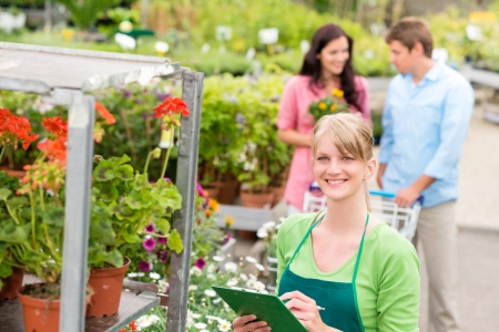Female florist working at garden centre retail inventory Stock Photo - 14735471