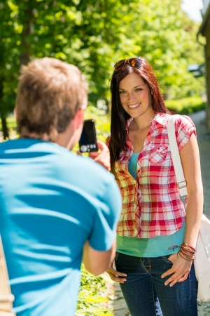 Young man take picture of his girlfriend outdoor city Stock Photo - 14735510