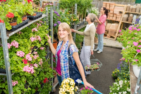 Woman shopping for flowers in garden centre  variation of plants Stock Photo - 14823853