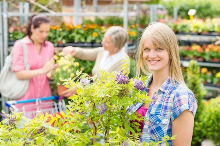 Smiling woman at garden centre shopping for house plants Stock Photo - 14823847