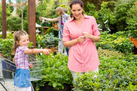 Little girl with her mum shopping at plant market Stock Photo - 14823852