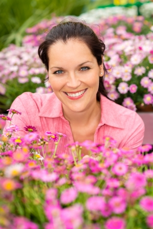 Portrait beautiful woman with purple daisy flowers in garden shop photo