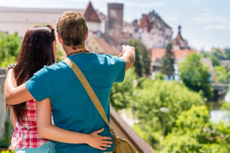 Young man showing woman the castle architecture vacation travel love photo