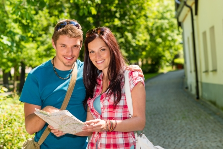Young couple look map smiling together in sunny park Stock Photo - 14899941