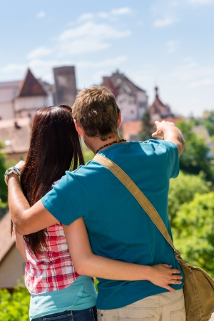 man behind: Young man pointing woman the castle architecture travel vacation love Stock Photo