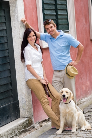 Modern couple with Labrador dog in the city photo