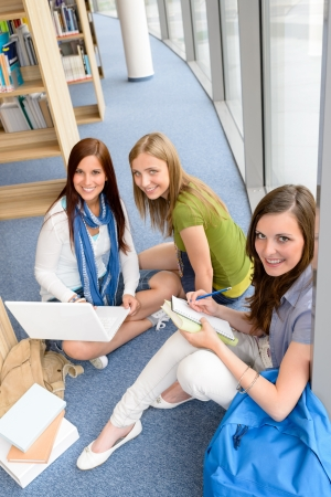 Group of high school students sitting floor self educating photo