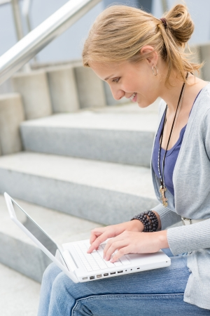Young woman working on her laptop computer student happy smiling Stock Photo - 14900086