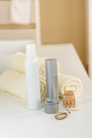 hairclip: Close-up of hair products and towels in bathroom Stock Photo