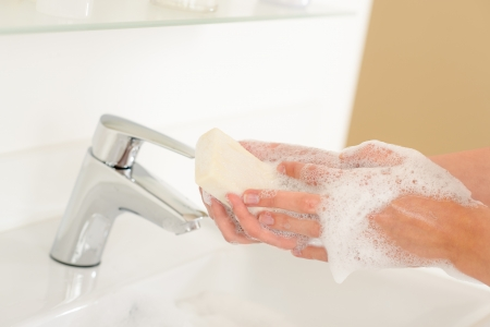 anti bacterial: Close-up of washing hands with soap above bathroom sink