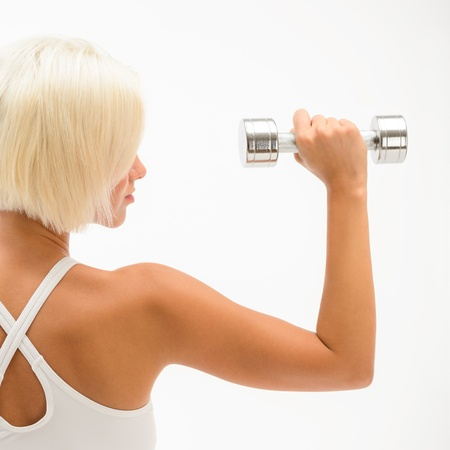 muscle arm: Back view portrait muscular blond woman holding dumbbell on white